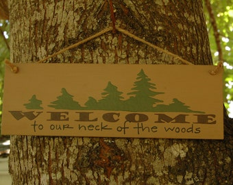 Welcome to our neck of the woods, wood sign