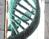 DNA strand wall plaque. Paper on salvaged wood.