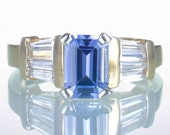14 Karat Yellow Gold Emerald Cut Ceylon Sapphire with Baguette Diamond Accents Solitaire Engagement Style Ring