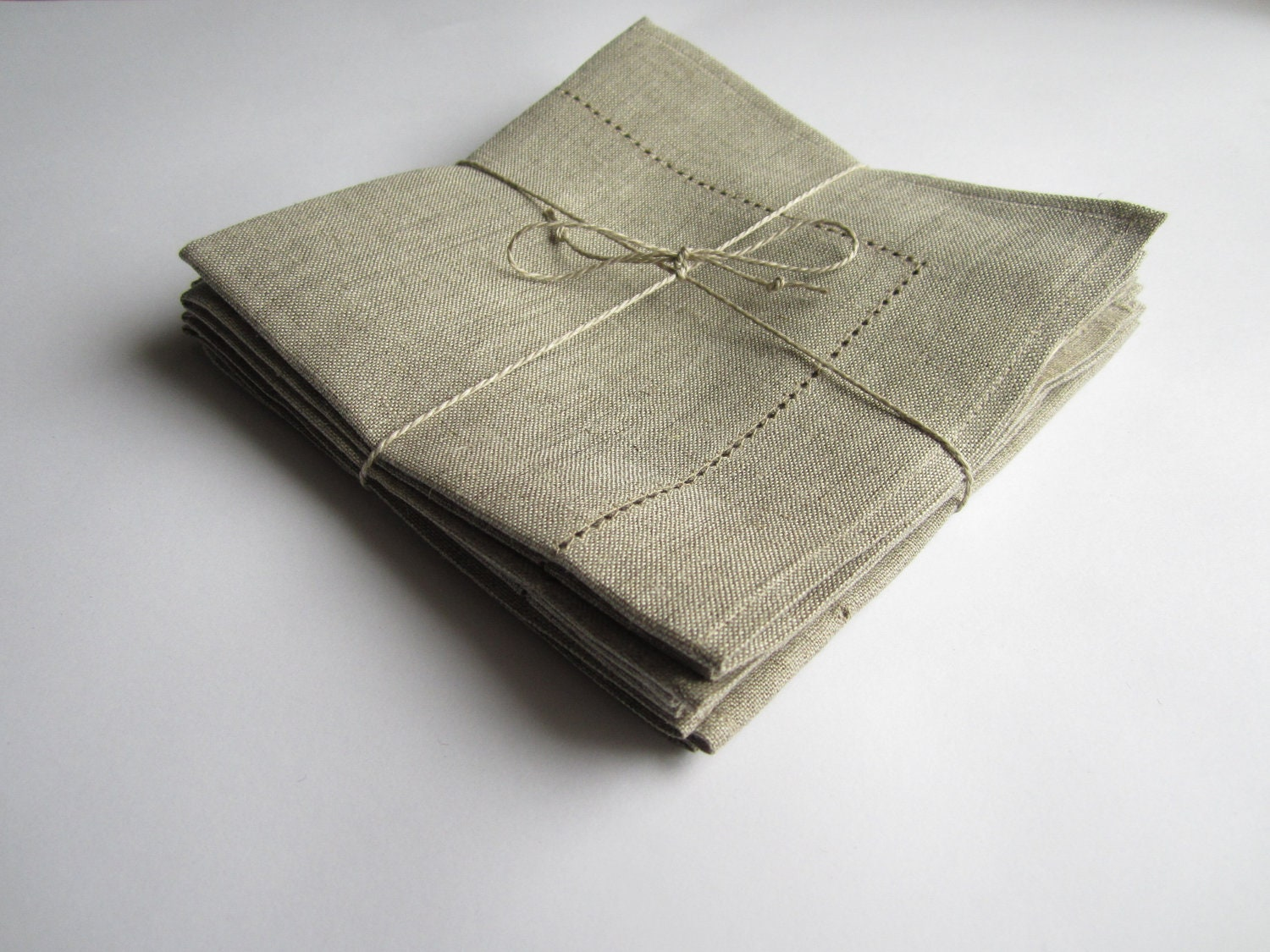 Menswear-inspired cloth napkins in four textural patterns and stripes bring a range of mixed neutrals to the table in crisp, hemmed linen. Details Suits Linen Cloth Dinner Napkins, Set .
