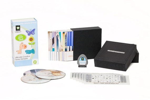 """Cricut  Cartridge - """" ULTIMATE SAMPLER with DVDs  """" - NeW - CONTAINs PORTIONs of 6 CARTRIDGEs in ONe"""