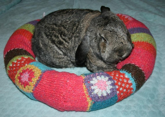Ugli Donut bunny bed for a large sized bunny hand crocheted cerise pink wool