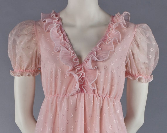 Pink Ruffles: Floor-length, sweeping dress with puffy sleeves