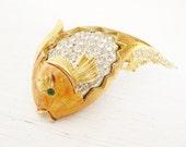 Gold fish. Golden enamel. Emerald eyes. THE KISSING FISH.