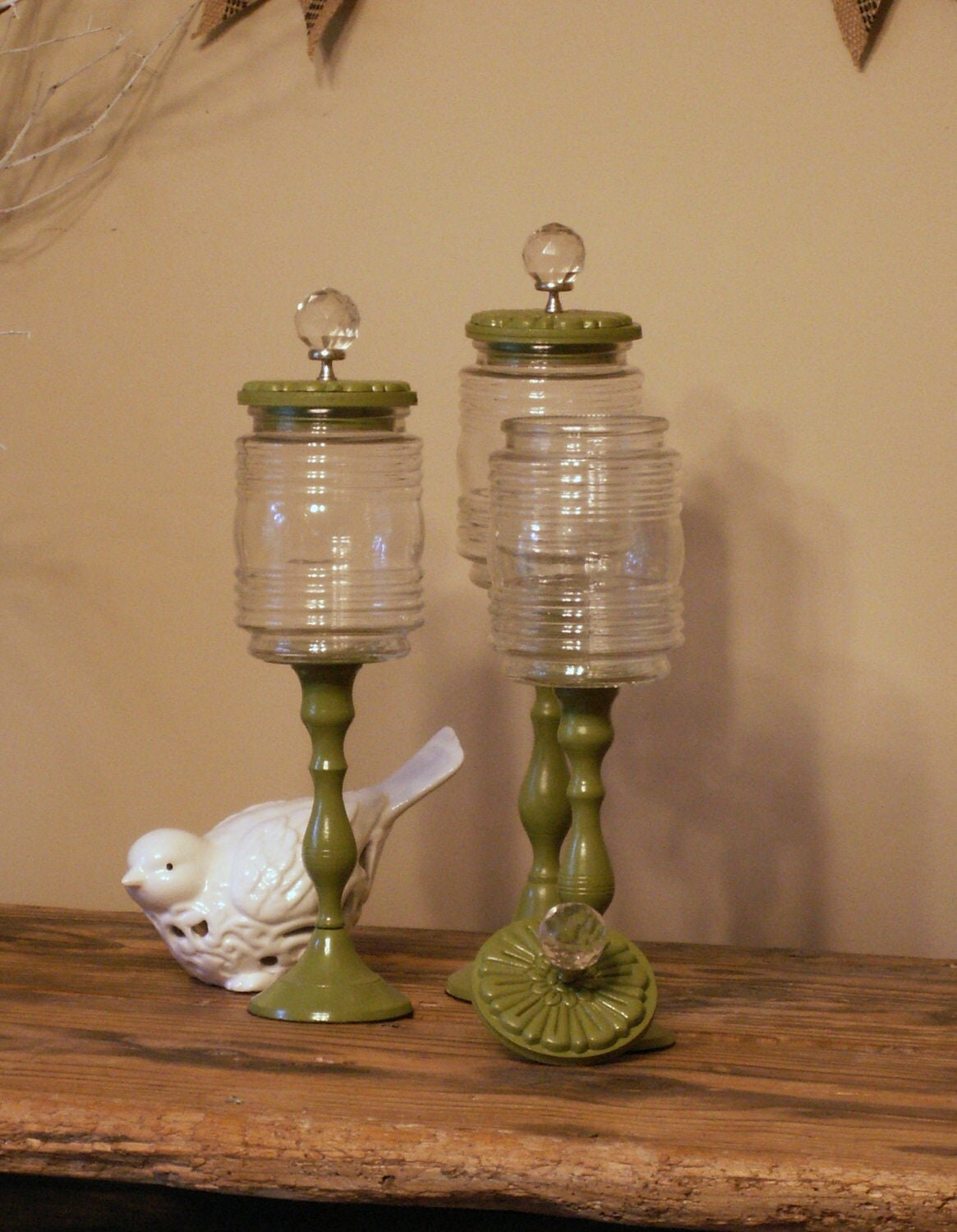 Green Apothecary Jars With Wooden Lids And Decorative Glass