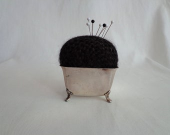 Hand knit pincushion with silver plated base