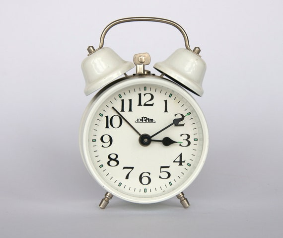 Vintage Czech small mechanical alarm clock from Prim. Dual bell. White.