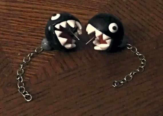 biting chain chomp stud earrings by mildlyartistic on etsy