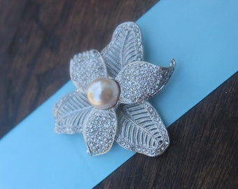 Beautiful  silver  color  flower  brooch with sparkling rhinestones