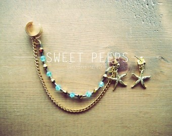 Gold Ear Cuff with Gold Starfish Set and a string of Beautiful Light Blue Crystals