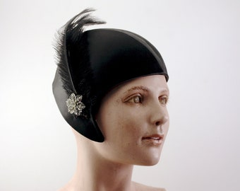 Vintage Black Flapper Hat with black feather and rhinestone clasp circa 1940's