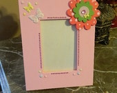 Pink picture frame.