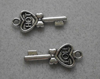 Silver Hot key with a  Heart Charms