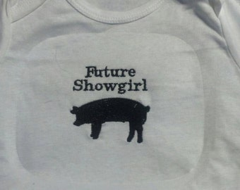 Custm embroidered onesie with a show pig