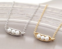 3 peas in a pod bracelet, gold and white.