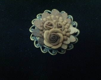 Classic Vintage plastic floral brooch set in brown, tans and beige colors
