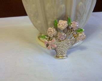 Petite and lovely Basket of flowers brooch is set with silver tone metal and pink and green enamel blooms and leaves