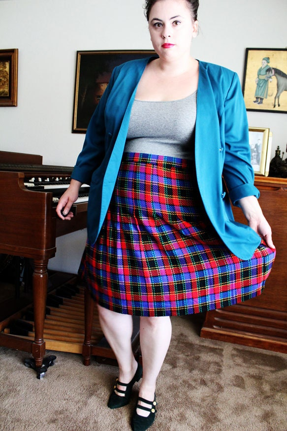 For a pleated variation of a plaid skirt, try one from Lauren by Ralph Lauren. Its classic sophisticated pieces make putting an outfit together simple. A plaid skirt is easily paired with various blouse options to create different looks.