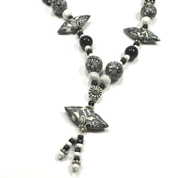 Black and white elegant necklace, Polymer clay necklace, unique necklace in abstract pattern, silver plated  charms, rich combination