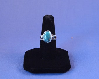 Sterling silver ring with turquoise stone.