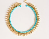 Turquoise necklace. Pretty bib necklace with spikes and crystals in turquoise and gold