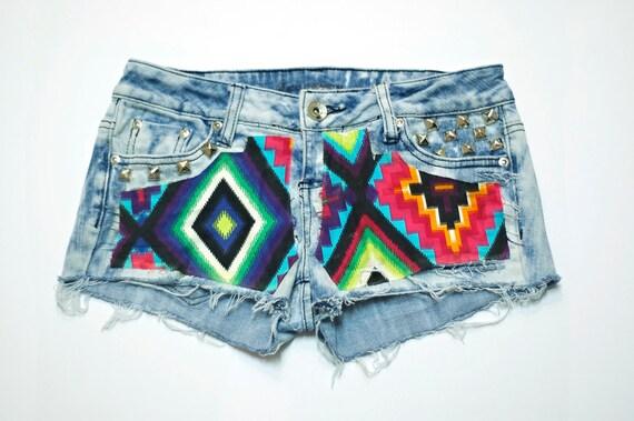 Aztec print on acid wash denim shorts with pyramid studs