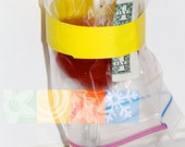 do-it-yourself FRUIT FLY TRAP featuring a wine glass, plastic bag, tap, cooking wine, sugar, and a dollar bill (Imperceivably Exotic)