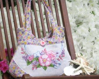 Hobo sytle handbag with featured vintage needlework