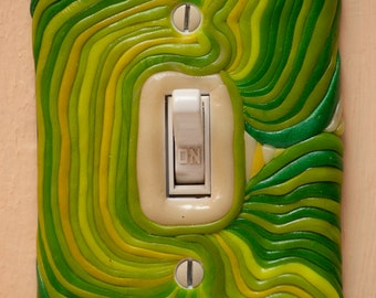 Spring greens glow-in-the-dark polymer clay switchplate cover