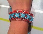 Coral and aqua reversible soda tab bracelet