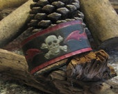 Handmade skull and flames leather cuff.
