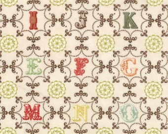 Vintage Alphabet  in reds, greens, yellows and browns on cream background.