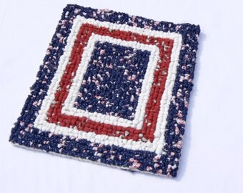 Red, white and blue made of recycled cotton fabric in a process called locker-hooking