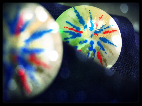 Firework Frenzy (vintage round white plastic post earrings with fireworks design in red blue and gold, 70s 80s)