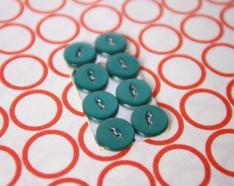 Emerald green vintage buttons on card