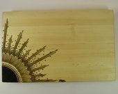 "7""x11"" Maple cutting board with sunburst design"