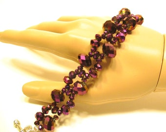 Beaded bracelet, Crystal bracelet deep purple with a touch of blue and gold on wire cord with a toggle clasp