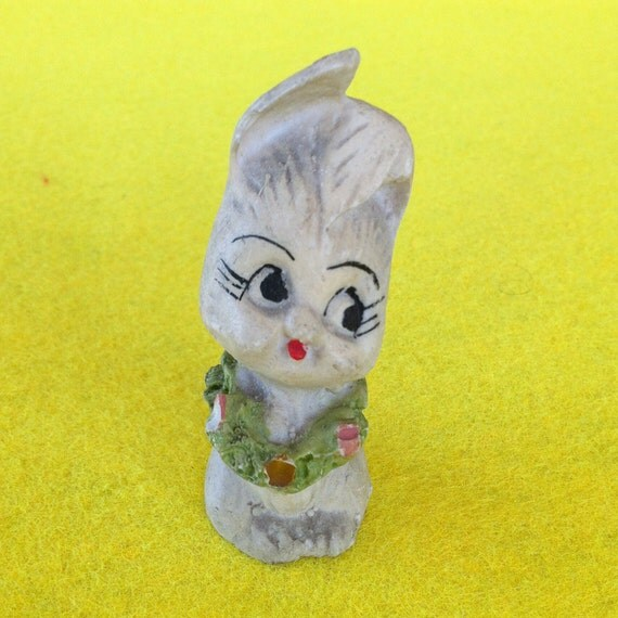 Vintage adorable big eyes bunny  with a wreath around his neck