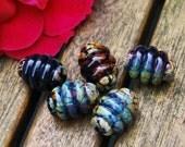 Black lampwork bead set (5) with raku frit - barrel shaped