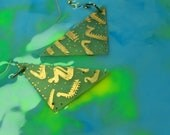 triangular semi-translucent etched copper earrings.