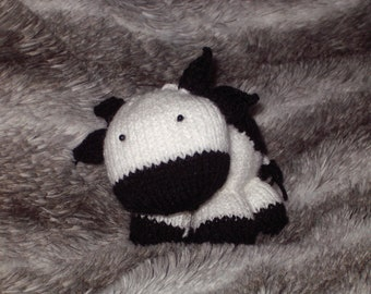 Knitted cuddly cow