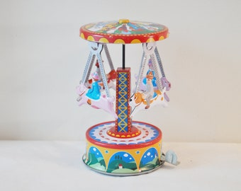 Vintage colourful carnival/carousel,  retro carnival ride toy, metal collectible, lever geared carousel toy, early nineties