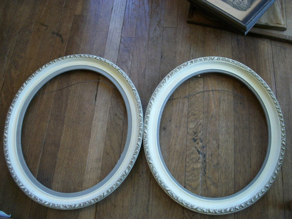 pair of vintage oval white ornate picture frames w leaf motif