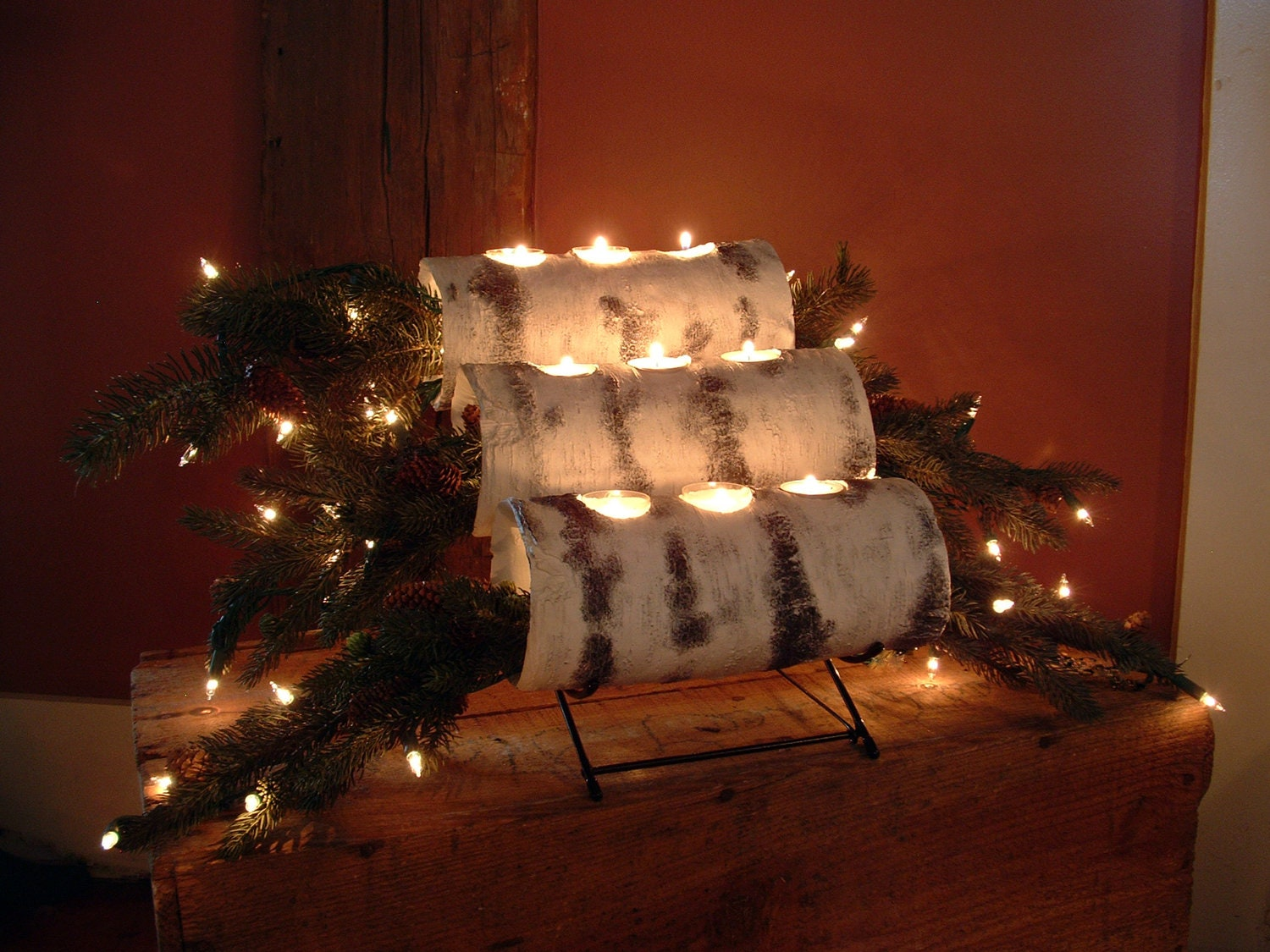 three tier birch yule log cradle with birch logs and prelit