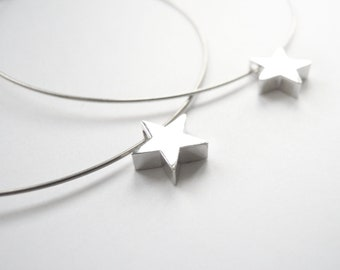 Circle silver earrings with tiny star bead