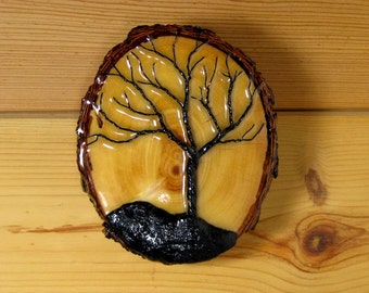 Decorative wall plaque with twisted wire tree.