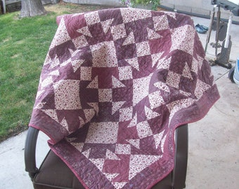 Quilted wall hanging or lap quilt. Machine pieced and quilted in beautiful burgandy colors