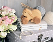 Rolling wooden rabbit, perfect birth gift or baby shower gift.