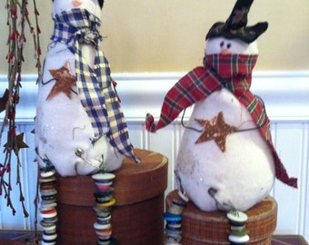 Primitive Sitting Snowman with Button Dangle Legs holding a Cinnamon Star