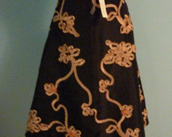 Decorative vintage black skirt with  ribbon trim and faux gemstones size small